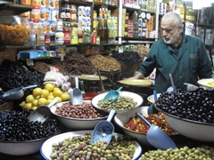 Olive seller; souq in Fes