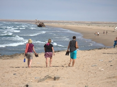 Walking towards a sandy beach; western Sahara