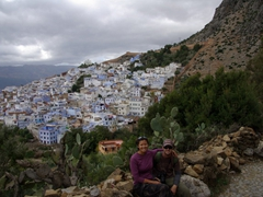 Posing in front of the scenic town of Chefchaouen