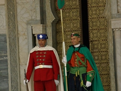 Guards stand smartly outside the marble Mausoleum of Mohammed V; Rabat