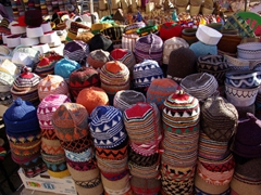 Hand knitted caps for sale (we bargained them down to 20 Dirhams each); Marrakesh market