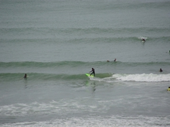 Surfers ride the waves; Rabat