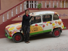 Becky poses next to a cute car; Todra Gorge