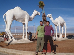 Posing by a camel monument roundabout; enroute through western Sahara