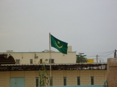 The Mauritanian flag flies over the city in Nouadhibou