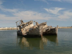 """The ocean around Nouadhibou are some of the world's richest in marine life, but many a ship has become a ship wreck casualty, causing one section of the beach to be known as """"Ship wreck Graveyard"""""""