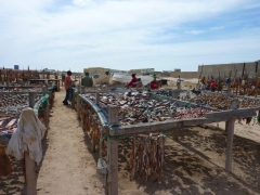 After several days of drying out in the sun, the fish parts are sent off to market as ingredients for a soup specialty