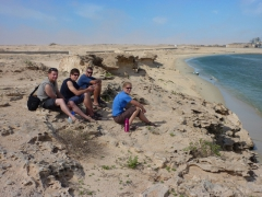 Taking a group break on a cliff overlooking one of Nouadhibou's beaches