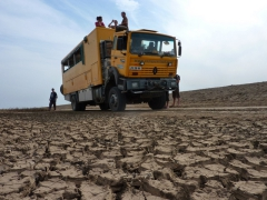View of a mud cracked road as Nala (our truck) takes a break; Diawling National Park