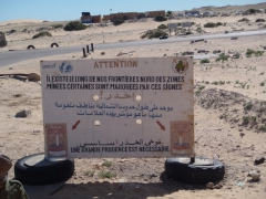 A signpost warning of land mines as we enter Mauritania