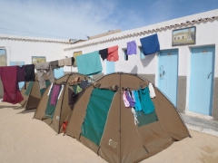 Getting cozy as we set up our tents in the tiny Camping Baie du Levrier; Nouadhibou