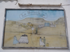 What a random painting! A security checkpoint graces the walls of our campsite in Nouadhibou