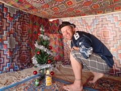 Lucky poses by our Christmas tree in Nouadhibou