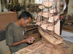 Shipbuilder working on model ships, Voiliers de L'Ocean, Curepipe