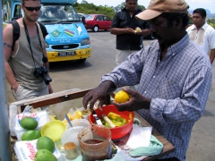 Robby buying fresh mangoes, Trou aux Cerfs