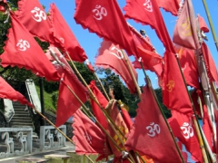 Hindu flags billowing in the wind, Grand Bassin