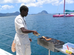 Grilling lobster on the catamaran cruise