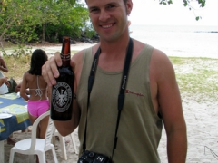 Robby downing a Phoenix beer, one of Mauritius' best local brews