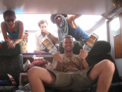 Robby posing with two empty bottles of Senegal Rum (bloody awful stuff) during our border crossing truck party