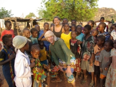 Becky and Matt strike a pose with the children of the village who so graciously supplied us some much needed water