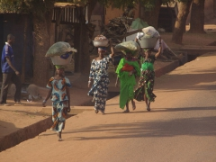 Ladies walking to the market to sell their wares; Kita