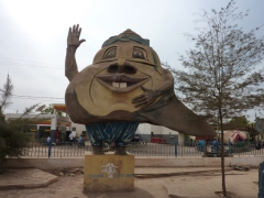 Large statue in front of the Shell gas station in Kayes