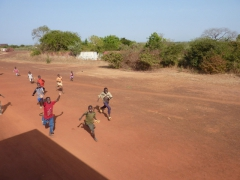 Excited children sprint after our truck; enroute to Bamako