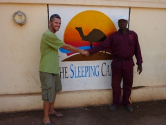 "Robby and the security guardsman at the excellent ""The Sleeping Camel"" in Bamako"