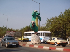 Bizarre dinosaur kicking a soccer ball monument in Bamako
