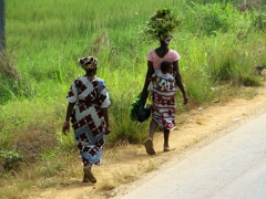 Village women walking by the roadside