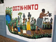 Wall mural outside the Python Temple which is the home for Ouidah's snake cult