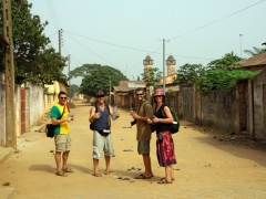 Dowelly, Lucky, Robby and Bree pose on Avenue de France in Ouidah