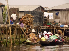 Shopping in Ganvie is conducted by pirogue, and the vendors hustle around trying to make a sale