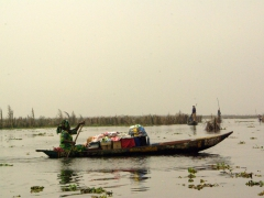 Hundreds of pirogues such as this one are filled to the brink with produce or merchandise, as the owners paddle from section to section in Ganvie attempting to lure potential customers