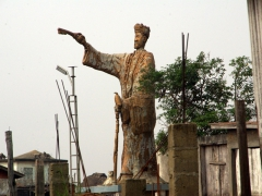 A massive statue dominates a construction site in Ganvie