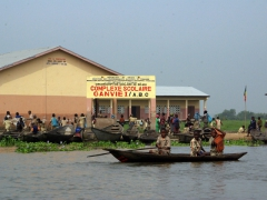 Children have to take pirogues to get to school in Ganvie