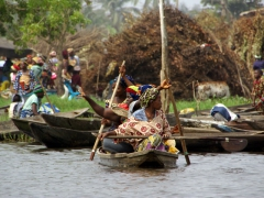 With a precarious load, these ladies slowly paddle their pirogue back to Ganvie Village