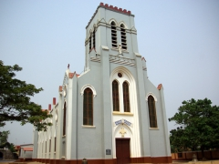 Ouidah Basilica sits just across the road from the Python Temple