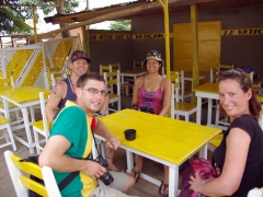 Lucky, Dowelly, Becky & Bree sitting down for a drink at the Le Vatican Bar; Ouidah