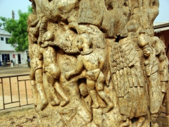 Intricate carvings covered a large tree stump at a major intersection of Ouidah