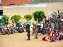 Carved wood crafts for sell outside the Door of No Return monument; Ouidah