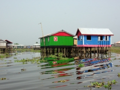 Colorful stilt houses; Ganvie Lake Village
