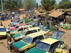 Taxis waiting for customers at a village market near Ouidah