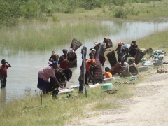 Local ladies using fishing baskets in roadside canals