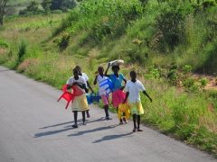 School children in Angola have to carry their own chairs to school!