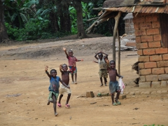 Happy kids from the village of Do Luvo wave while running after our truck