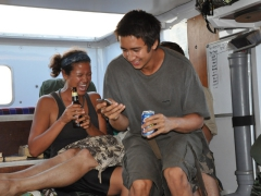 Becky, Dowelly and Luke acting goofy during the truck party; near N'Zeto