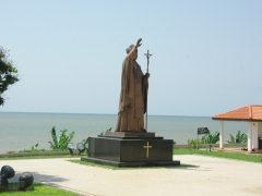 Church statue on the waterfront in Cabinda