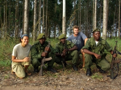 Posing with our Angolan guards who roamed about our campsite armed with AK47s near Yema