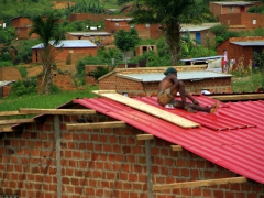 An Angolan works on his roof